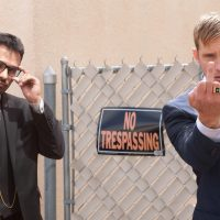 Michael Peña as Bob Bolano and Alexander Skarsgård as Terry Monroe in WOE by John Michael McDonagh-poster  copy